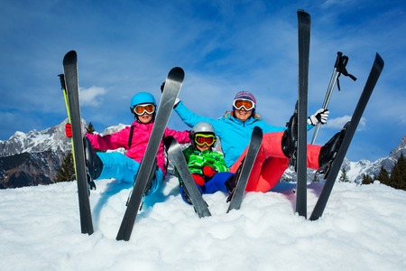 snow woman: family enjoying winter vacations  Stock Photo