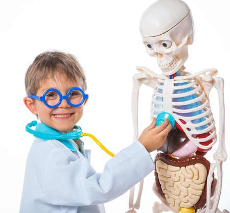 smock: A little smiling doctor with stethoscope and skeleton  Isolated on white background