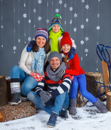 Winter Fashion  Happy family in winter hat gloves and sweater in studio  photo