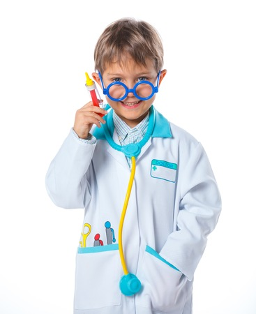 Portrait of a little smiling doctor with stethoscope and syringe  Isolated on white background