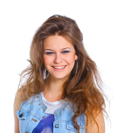 Teenagre girl grimacing  Face portrait against white background photo