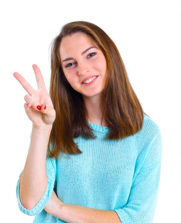 Portrait of happy teenage girl in a blue dress  Isolated over white background  photo