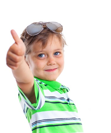 Close-up portrait of a boy with sunglasses and wearing green clothing  Isolated on white background photo