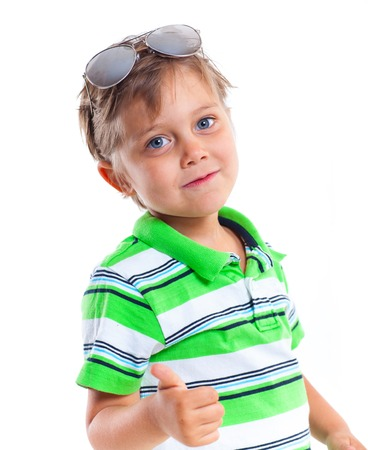 baby 4 5 years: Close-up portrait of a boy with sunglasses and wearing green clothing  Isolated on white background