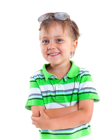 baby 4 5 years: Portrait of a boy with sunglasses and wearing green clothing  Isolated on white background