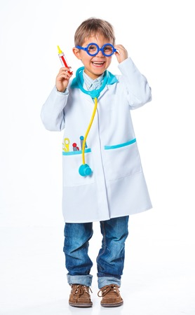 doctor s smock: Little smiling doctor with stethoscope and syringe  Isolated on white background