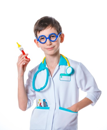 doctor s smock: Portrait of a little smiling doctor with stethoscope and syringe  Isolated on white background