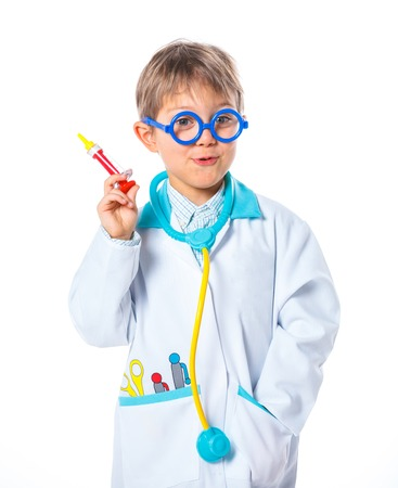 Portrait of a little smiling doctor with stethoscope and syringe  Isolated on white background photo