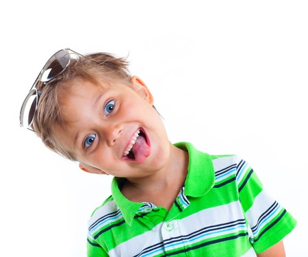 Portrait of a grimacing boy with sunglasses and wearing green clothing  Isolated on white background photo