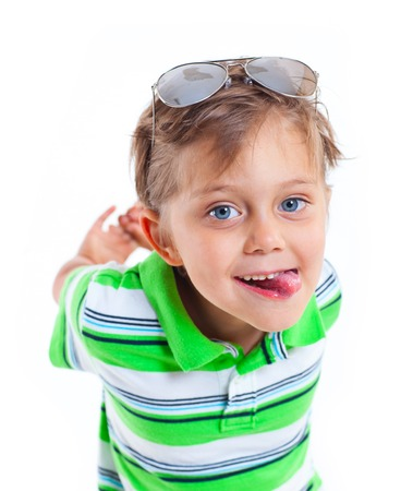 baby 4 5 years: Portrait of a grimacing boy with sunglasses and wearing green clothing  Isolated on white background