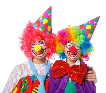 clown's nose: Portrait of a cute boy and girl clowns  Isolated on white