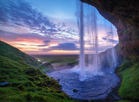 waterfall with sky: Seljalandfoss waterfall at sunset, Iceland  Horizontal shot