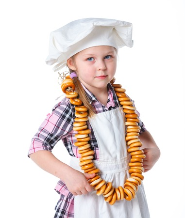 Little Cook With A Bagels In Her Hands  Isolated on white background photo
