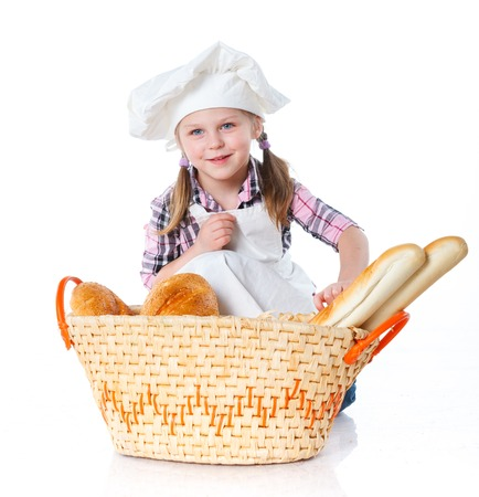 Little Cook With A Backet With Bread  Isolated on white background  photo