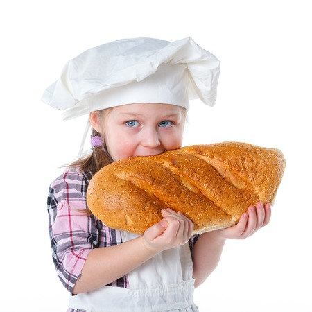 Little Cook With Bread  Isolated on white background  photo