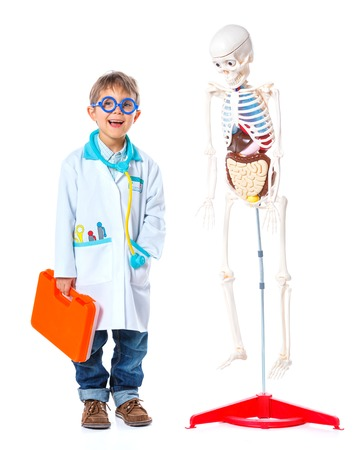 doctor s smock: A little smiling doctor with stethoscope and skeleton  Isolated on white background