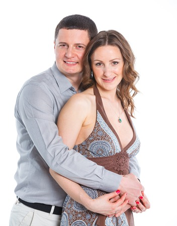 stodio: Portrait of happy couple  Attractive man and woman being playful  Isolated on white background