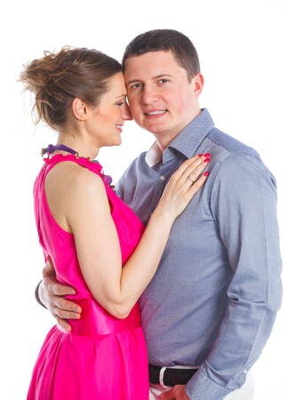stodio: Happy couple  Attractive man and woman being playful  Isolated on white background