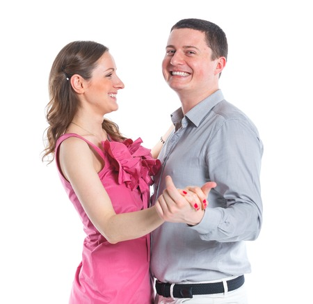 Portrait of happy couple  Attractive man and woman being playful  Isolated on white background