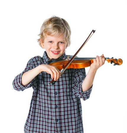 little handsome boy playing the violin isolated on white photo