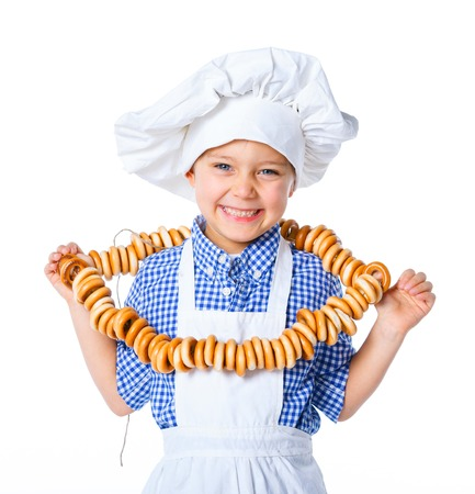 Little Cook Boy With A Bagels  Isolated on white background  photo