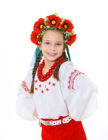 A little girl in Ukrainian national dress on the white background Stock Photo