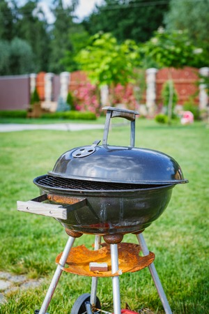 Grilling theme with barbecue stuff  Kettle barbecue grill  photo