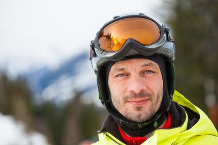 fmale: Portrait of male skier