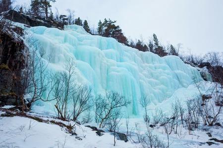 Frozen waterfall in Norway photo