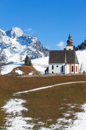 Beautiful winter view of church in Austria. Vertical view photo