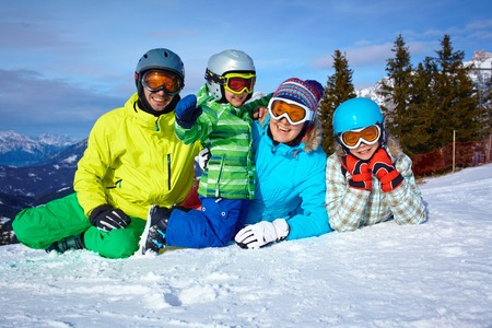 Skiers, sun and fun photo