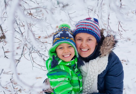 Winter boy with mother photo