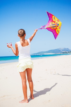 Girl with kite photo