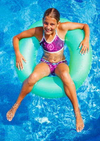 recreational sports: Girl swims in a pool Stock Photo