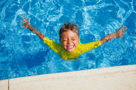young boy in pool: Boy in the pool