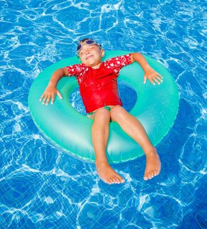 little boy swimming: Boy swims in a pool Stock Photo