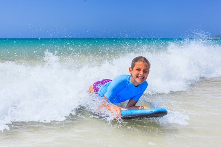 surfing wave: Girl with surf