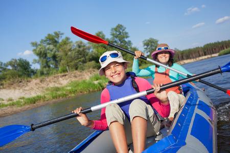kayak: Girl with mother kayaking Stock Photo