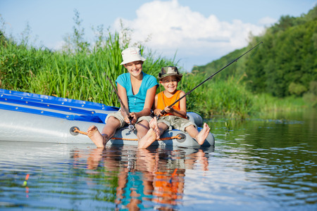 Kids fishing at the river photo