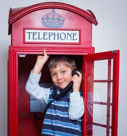 電話の少年 写真素材
