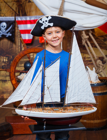 Boy with ship Stock Photo