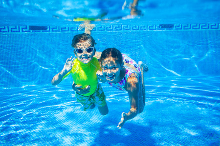young boy in pool: Underwater kid Stock Photo