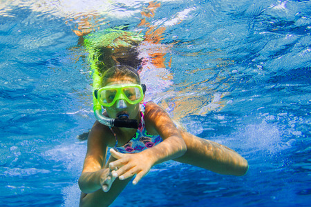 snorkeling: Underwater girl snorkeling