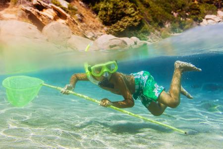 skin diving: Underwater boy snorkeling