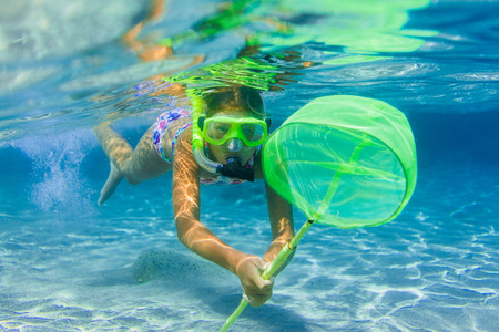 skin diving: Underwater girl snorkeling