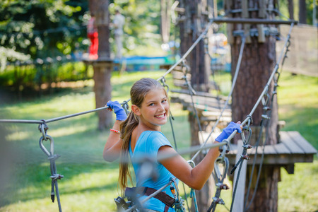 Girl in a climbing adventure park Stok Fotoğraf