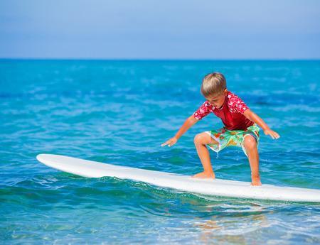 Boy with surf Standard-Bild