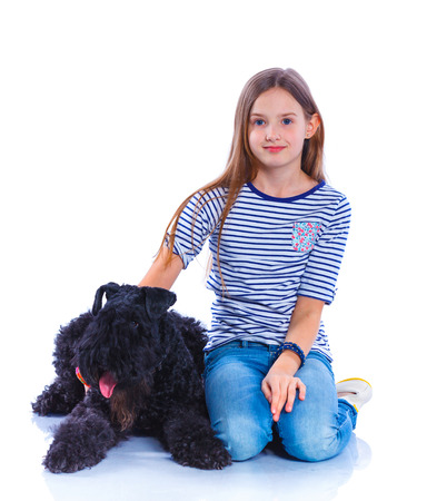 kerry blue terrier: Cute girl sitting with his Kerry Blue Terrier smiling at camera on isolated white background