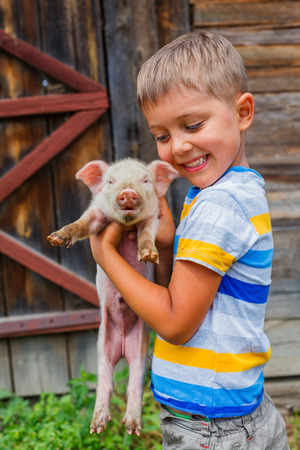 cary: Boy with piglet