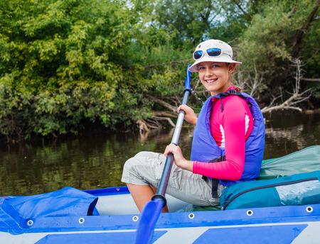 summer activities: Girl kayaking Stock Photo